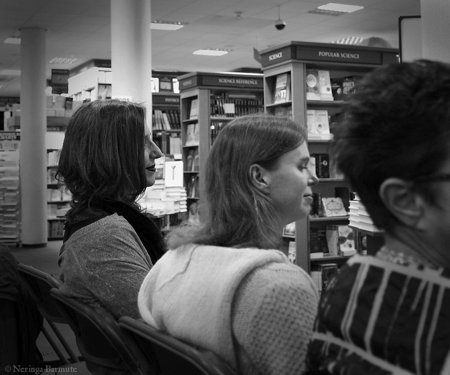 Elise Valmorbida sitting among the audience while listening to her story being read out aloud